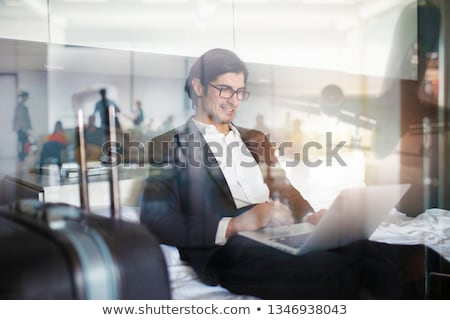 Traveler businessman with his laptop ready to fly. Double exposure Stock photo © alphaspirit