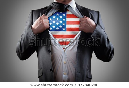 superhero businessman with American flag on chest Stock photo © choreograph