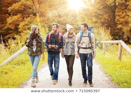 friends or travelers with backpacks and tablet pc Stock photo © dolgachov