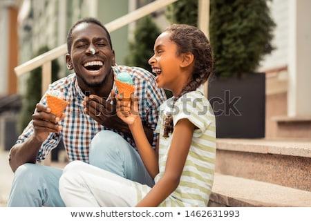 dad and daughter eating ice cream stock photo © kzenon