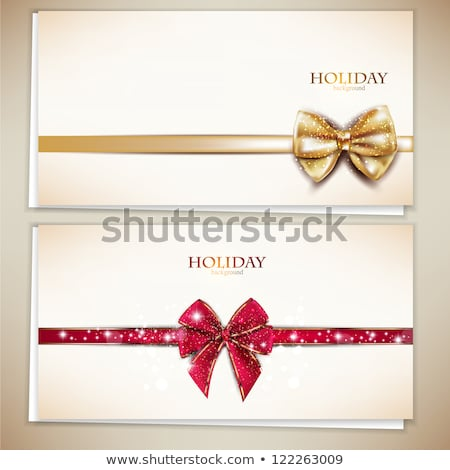 Stock photo: Golden bow with tapes and snowflakes
