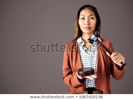 Kadın yargıç tokmak kahverengi dijital bileşik el Stok fotoğraf © wavebreak_media