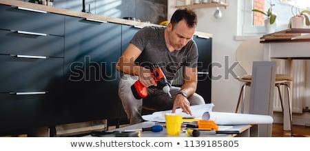 człowiek · meble · domu · strony · śrubokręt · piętrze - zdjęcia stock © elnur