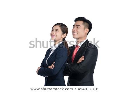 Yandan görünüş mutlu Asya işadamı bakıyor kamera Stok fotoğraf © wavebreak_media