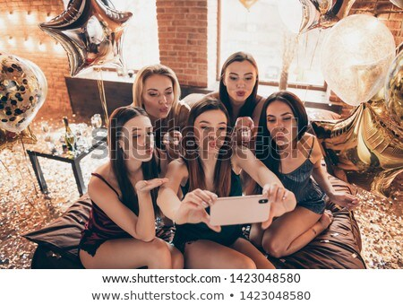 Girls women friends at the hen party at home kissing. Stock photo © deandrobot