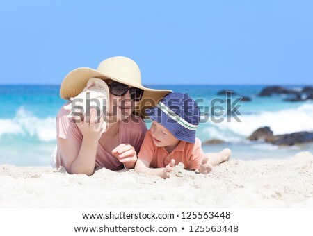 Mother and child lies in wave on shore Stock photo © Paha_L