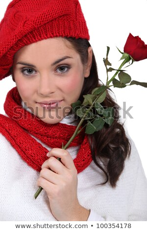 pretty brunette with red rose and assorted winter clothing Stock photo © photography33