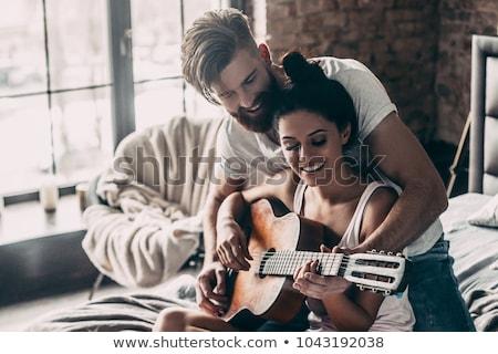 portret · posiedzenia · gitara · ognisko · szczęśliwy - zdjęcia stock © photography33