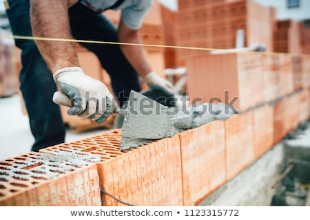 bricklayer using trowel Stock photo © photography33