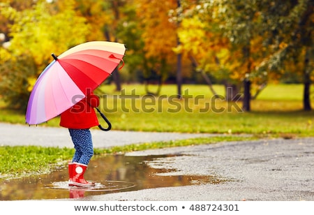 Portrait of a girl after rain Stock photo © d13