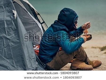 Tourist in camp Stock photo © zastavkin