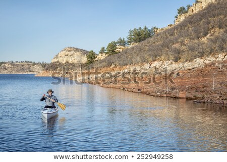 canoe and Colorado mountain lake in early spring Stock photo © PixelsAway