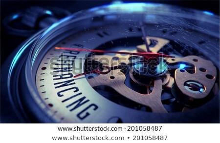 refinancing on pocket watch face time concept stock photo © tashatuvango