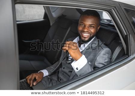 business man thinking back seat car stock photo © hasloo