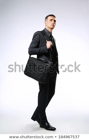 Geschäftsmann Tasche nachschlagen grau Hintergrund Kontakt Stock foto © deandrobot