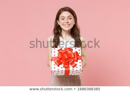 Cheerful woman holding a cardboard box Stock photo © HASLOO