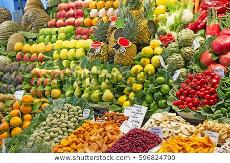 Many various Fresh fruit at a market stall in Barcelona Stock photo © smuki