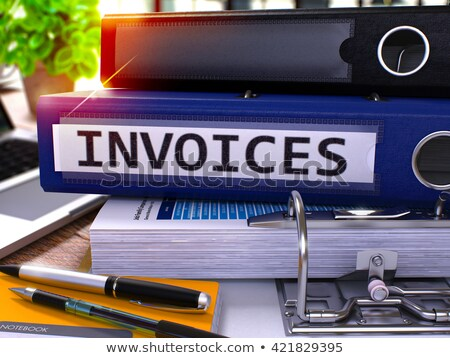 Invoices on Office Binder. Toned Image. Stock photo © tashatuvango