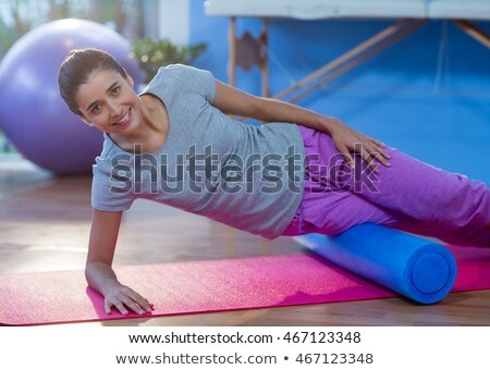 Woman performing exercise using foam roll Stock photo © wavebreak_media