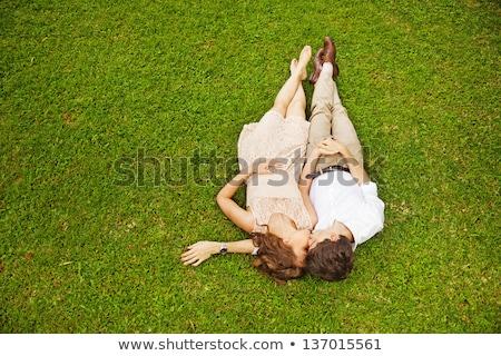 amoroso · casal · grama · sorrir · cara · amor - foto stock © Minervastock