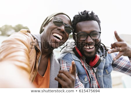 two cheerful african man friends stock photo © deandrobot