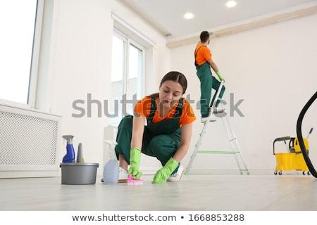 Homme seau nettoyage étage maison domestique Photo stock © dolgachov