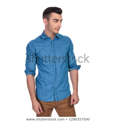 portrait of curious casual man looking down to side Stock photo © feedough