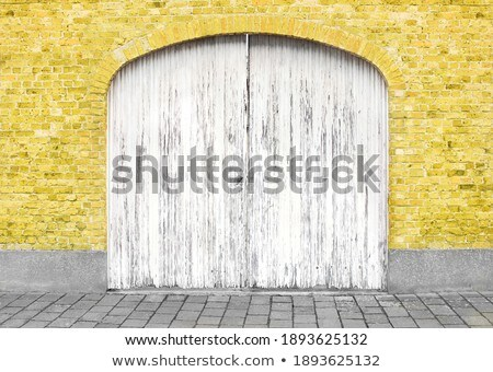 Facade brick old wall with painted door in a trendy color of the year 2019 Living Coral Pantone. Stock photo © artjazz