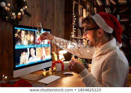 Szczęśliwy para christmas strony uroczystości ludzi Zdjęcia stock © dolgachov