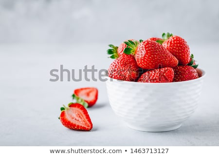 Strawberry in the bowl on a green background. Stok fotoğraf © Illia
