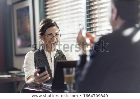 Man with ponytail and glasses holding a laptop Stock photo © Giulio_Fornasar