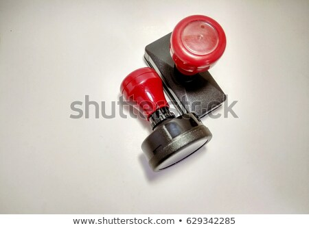 A red stamp on a white background - Approved Stock photo © Zerbor