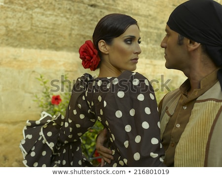 Man And Woman Dancing Flamenco In Traditional Clothes Stock photo © diego_cervo