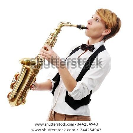Jonge vrouw spelen saxofoon muziek mode model Stockfoto © yupiramos