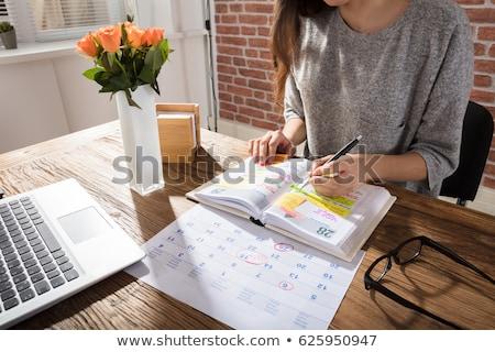 Vrouw naar maand agenda kalender laptop computer Stockfoto © AndreyPopov