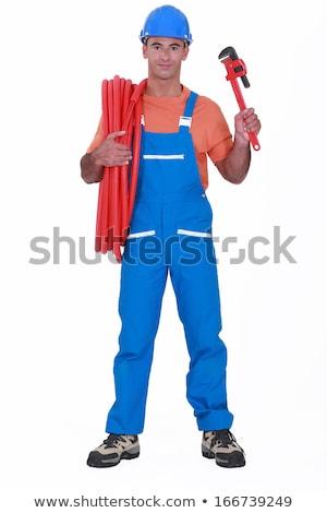 Kereskedő tart csőrendszer cső franciakulcs építkezés Stock fotó © photography33