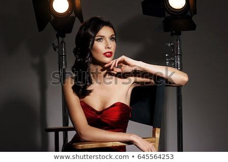Bela mulher preto vestido de noite posando cadeira estúdio Foto stock © Pilgrimego