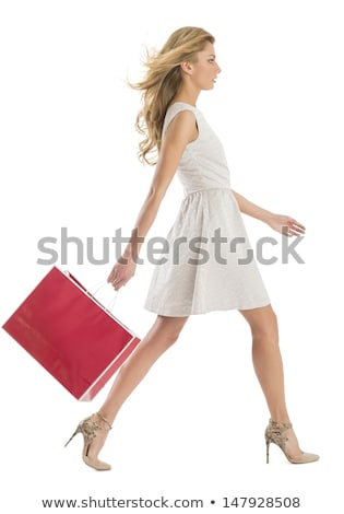 Sarışın kadın çanta gülümseyen kadın hediye atlama Stok fotoğraf © Flareimage