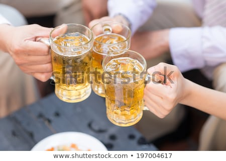 Gardener enjoying a refreshing iced drink Stock photo © ozgur