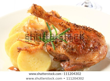 Roast duck legs with caraway and onion stock photo © Digifoodstock