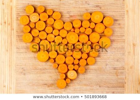 Fresh sliced orange carrots arranged in a heart Stock photo © ozgur