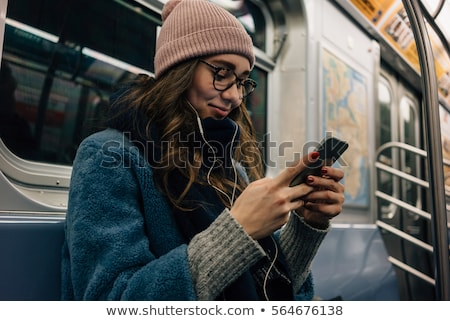 Portrait of a lovely young girl student in earphones Stock photo © deandrobot