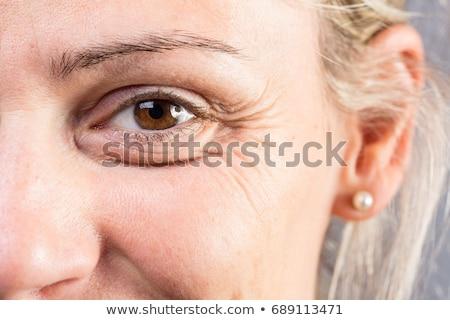 Wrinkled eye of beautiful lady Stock photo © boggy
