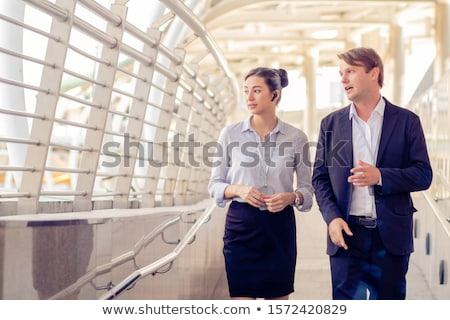 Business people work together in office with a laptop. Concept of teamwork and partnership Stock photo © alphaspirit