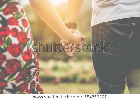 любви пару , держась за руки вечер закат счастливым Сток-фото © ruslanshramko