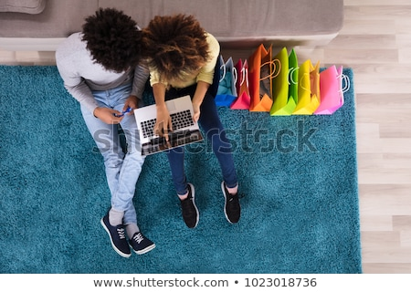 High Angle View Of A Couple Shopping Online On Laptop Stock photo © AndreyPopov
