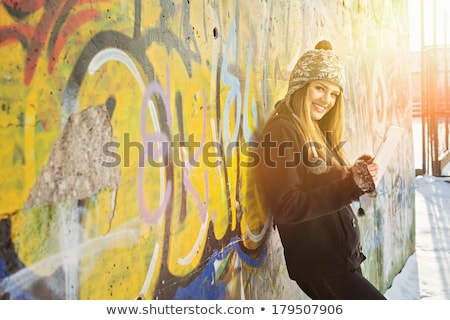 Laughing carefree young woman holding a tablet-pc Stock photo © Giulio_Fornasar