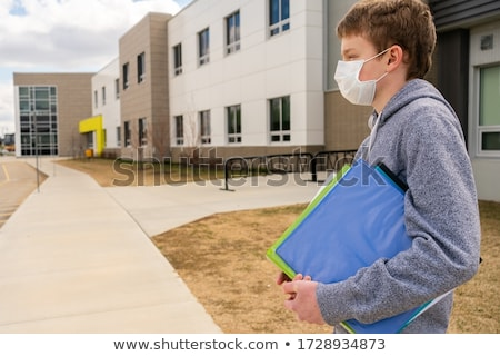 Boy Standing Outside School With Rucksack Stock photo © Lopolo
