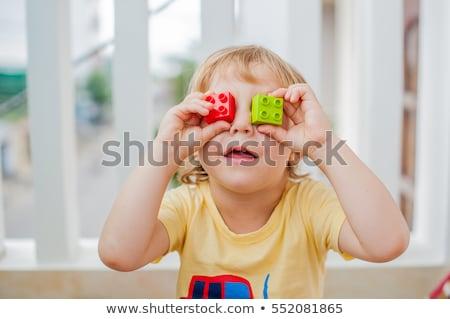 Garçon yeux coloré blocs cute peu Photo stock © galitskaya
