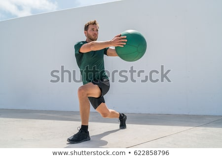 Fitness man working out abs with medicine ball Stock photo © Maridav